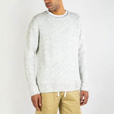 Polar melange long sleeved round collar jumper.