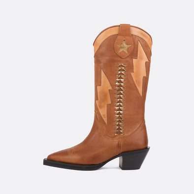 Upper-high brown leather boots with a perforated star and a golden interior.