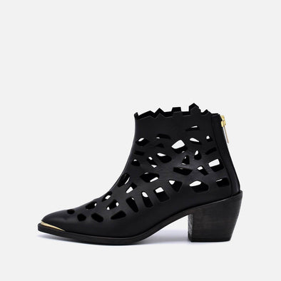 Black heeled ankle boots with perforated leather and golden details.