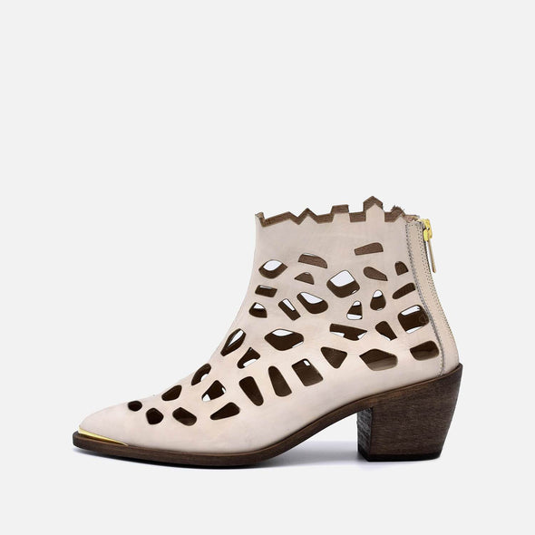 White heeled ankle boots with perforated leather and golden details.