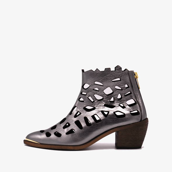Perforated leather bronze heeled ankle boots with golden details.