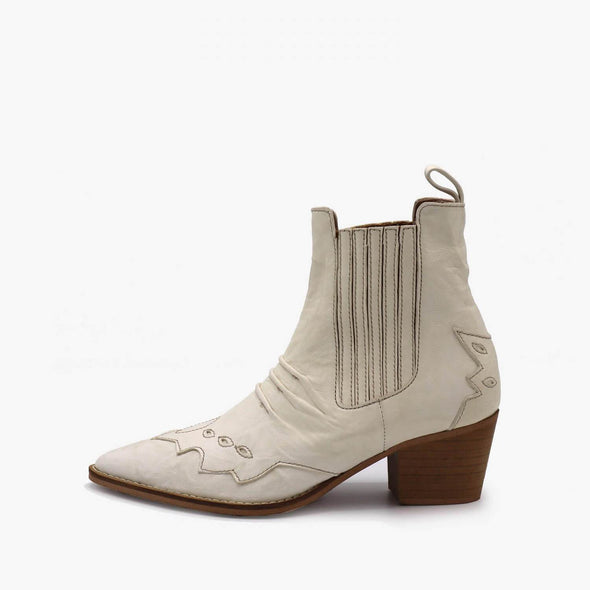 Off-white leather western ankle boots with wooden heel.