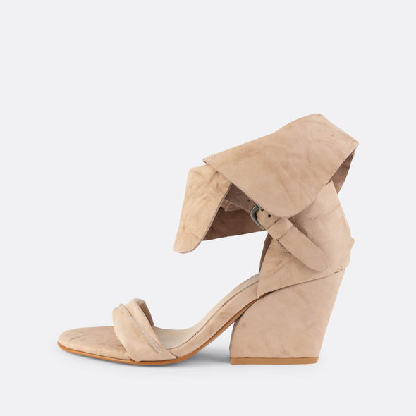 Nude leather heeled sandals with na ankle band.