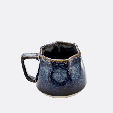 Small ceramic mug with crinkle finish in midnight blue.