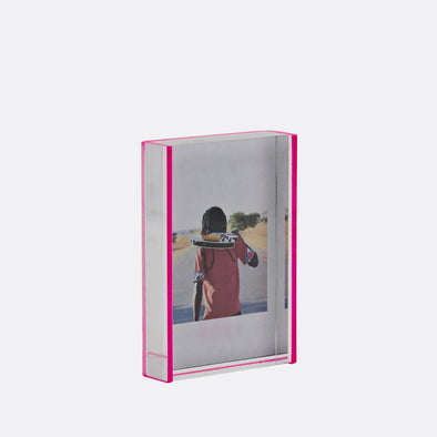 2x3 acrylic photo frame with sliding pink back.