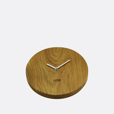 Pure oak 22cm wall clock.