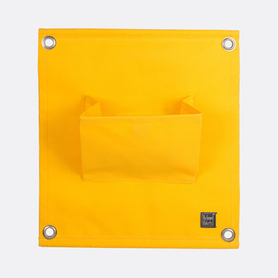 Yellow modular pocket to create an interior/exterior vertical garden.