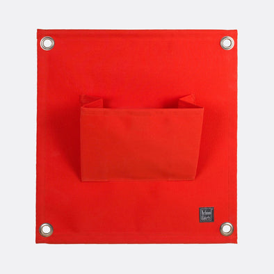 Red modular pocket to create an interior/exterior vertical garden.