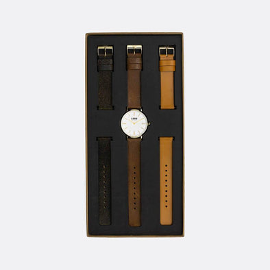 Gold 39mm watch with vintage brown , black and tan leather straps.