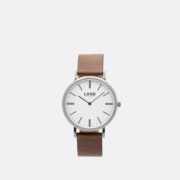 Nude leather watch with 39mm silver dial.