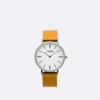 Tan leather watch with 39mm silver dial.