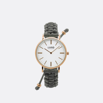 Grey braided watch with 34mm rose gold dial.