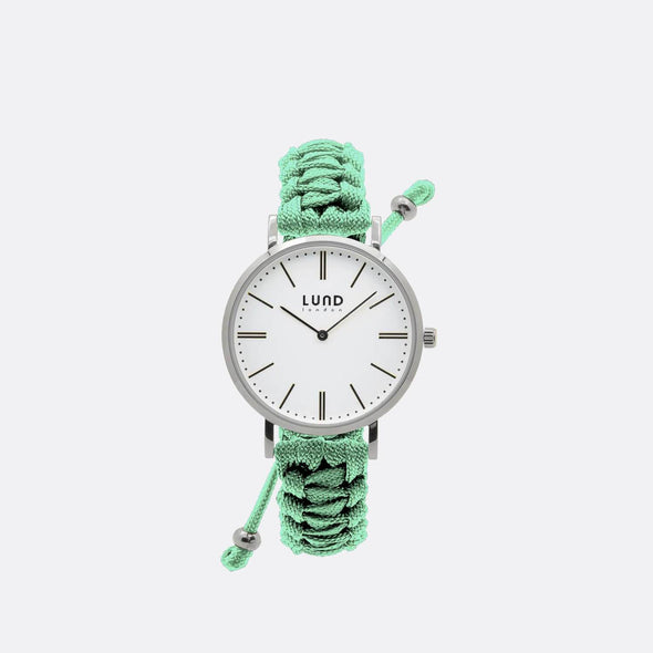 Mint green braided watch with 39mm silver dial.
