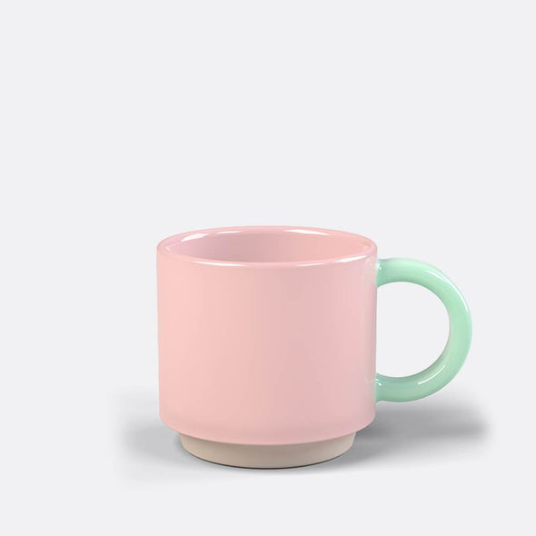 Stackable pink and mint hand finished ceramic mug.
