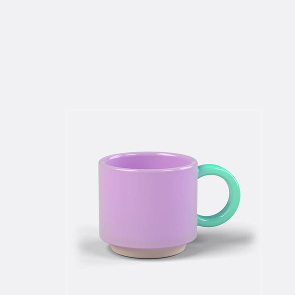 Stackable lilac and turquoise hand finished ceramic espresso mug.