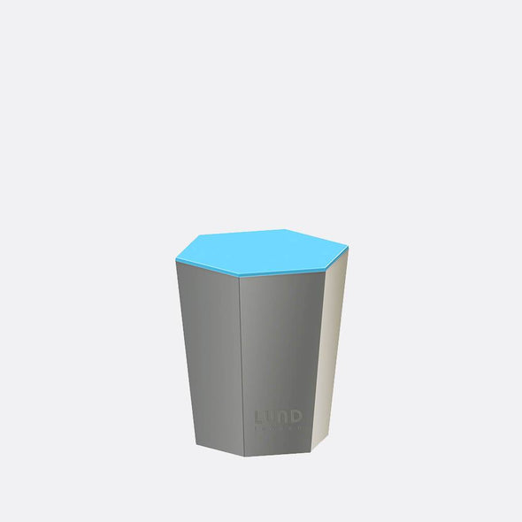 Grey and blue lidded candle with a rich and decadent amber and cedarwood fragrance.