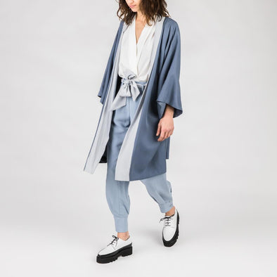 Blue kimono with light blue details and belt.