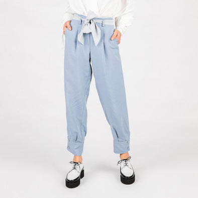 Light blue trousers with side pockets.