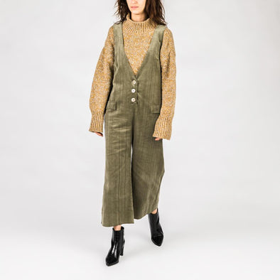 Olive green corduroy jumpsuit with button placket.