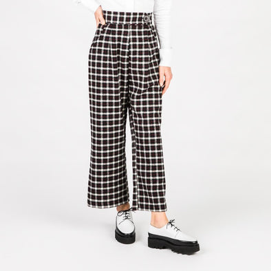 Patterned trousers in black, white and red.