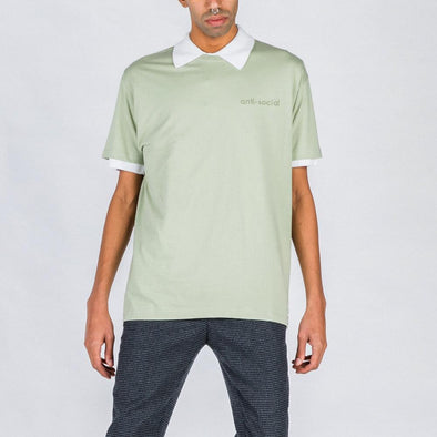 Pastel green t-shirt with matching embroidery.