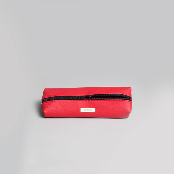 Water resistant pencil case in red vegan leather.