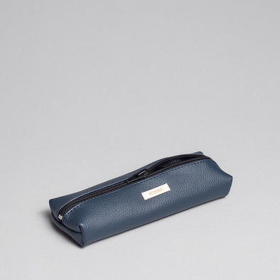 Water resistant pencil case in navy blue vegan leather.