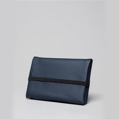 Unisex essential pouch in navy blue vegan leather.