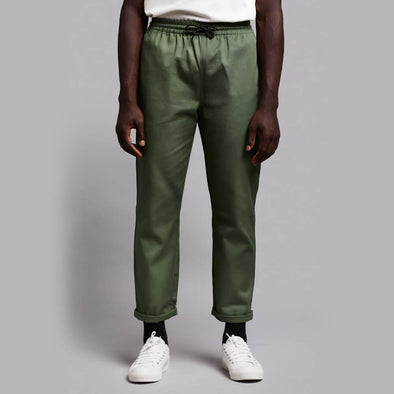 Workwear inspired green pants with elastic waistband.