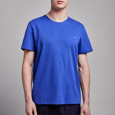 Minimalist blue t-shirt with round collar and white chest embroidery.