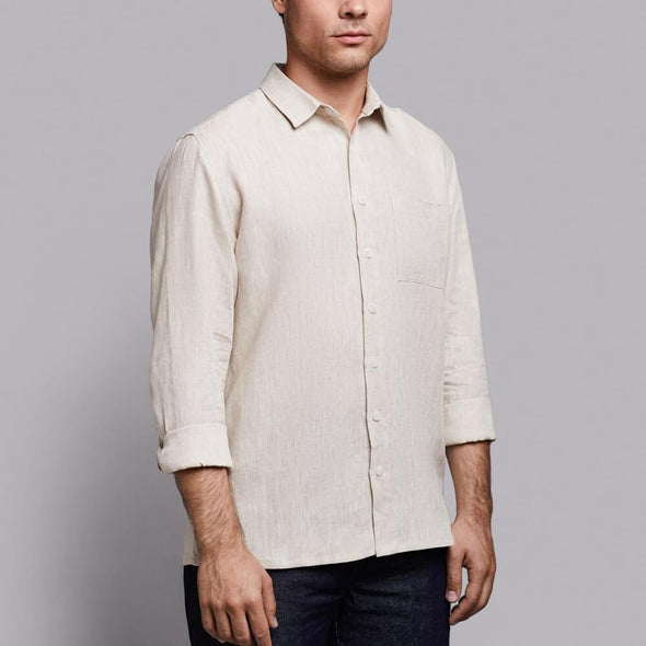 Beige linen shirt with chest pocket and buttoned cuffs.
