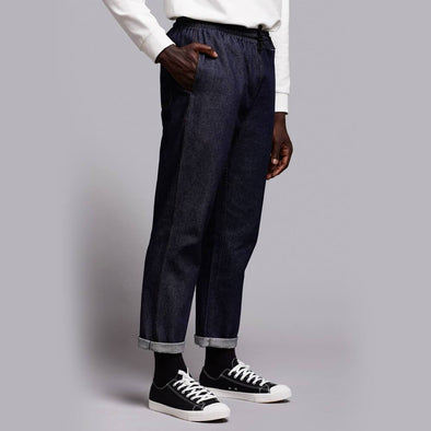 Workwear inspired dark denim pants with elastic waistband.