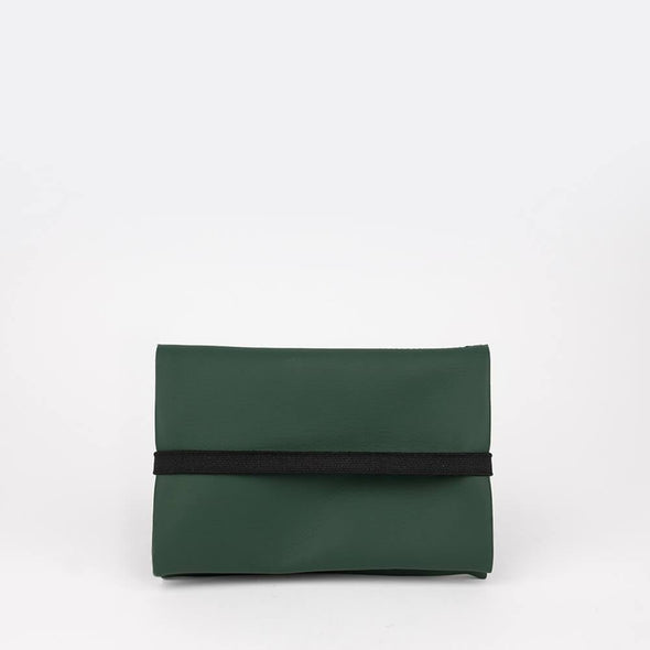 Unisex essential pouch in forest green vegan leather.
