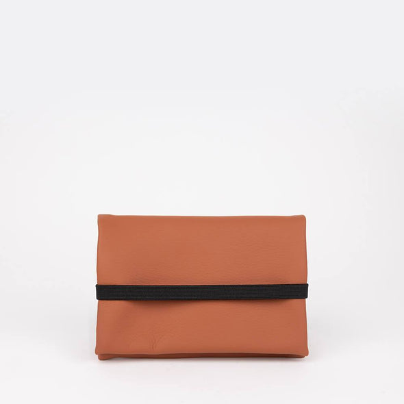 Unisex essential pouch in ochre orange vegan leather.