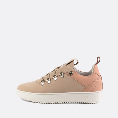 Minimalist nude leather sneakers with a sleek silhouette.