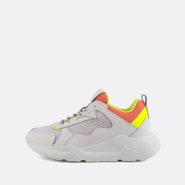 Lightweight white runners with a pop of yellow and orange.