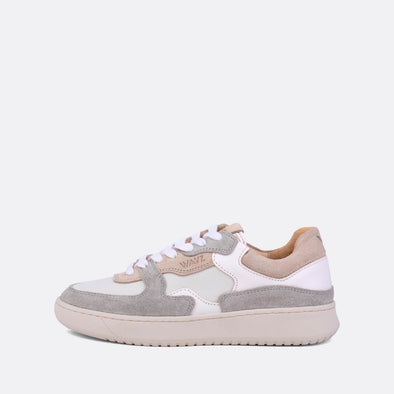 Low-top sneakers in almond milk, light grey and white.
