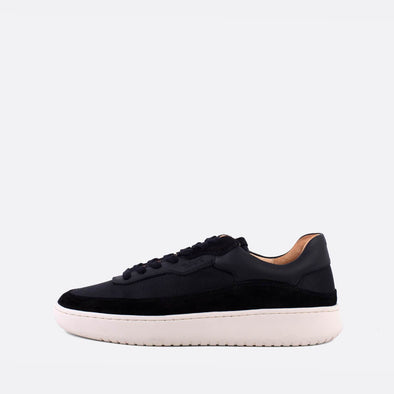 Low-top sneakers in black leather and suede.