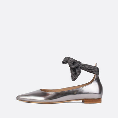 Silver leather ballerinas with fabric strap to tie at the ankle.