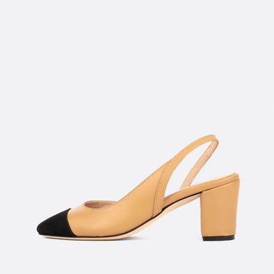 Nude leather slingback mules with black suede toe cap.