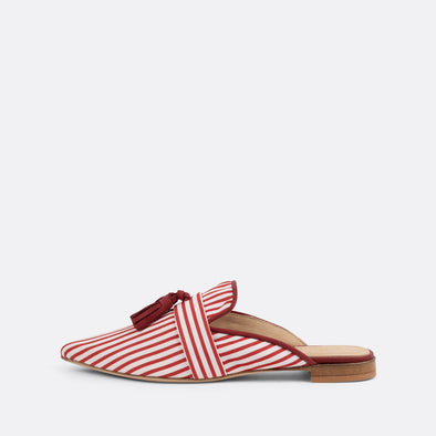 Pointed toe striped mules topped with lovely tassels.