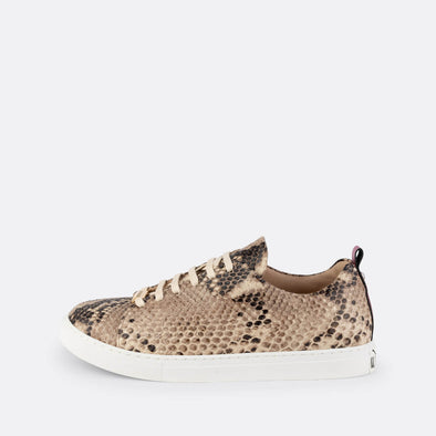 Python leather sneakers with rubber sole and pink leather detail.