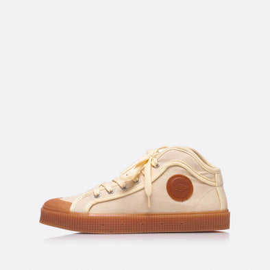 High-top sneakers in beige with brown sole.