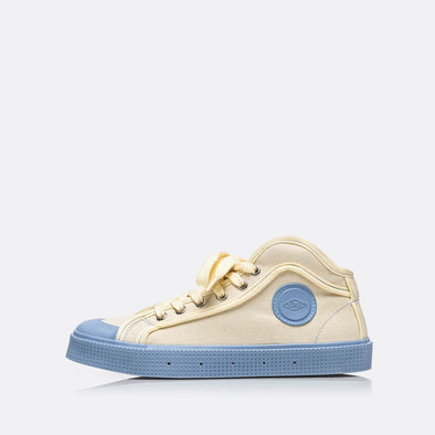 High-top sneakers in beige with blue sole.