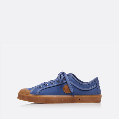 Low-top sneakers in blue with brown sole.