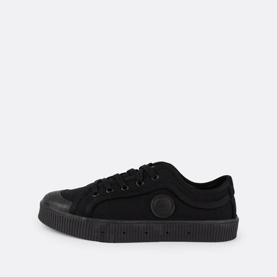 Iconic low-top sneakers in black canvas with matching sole.