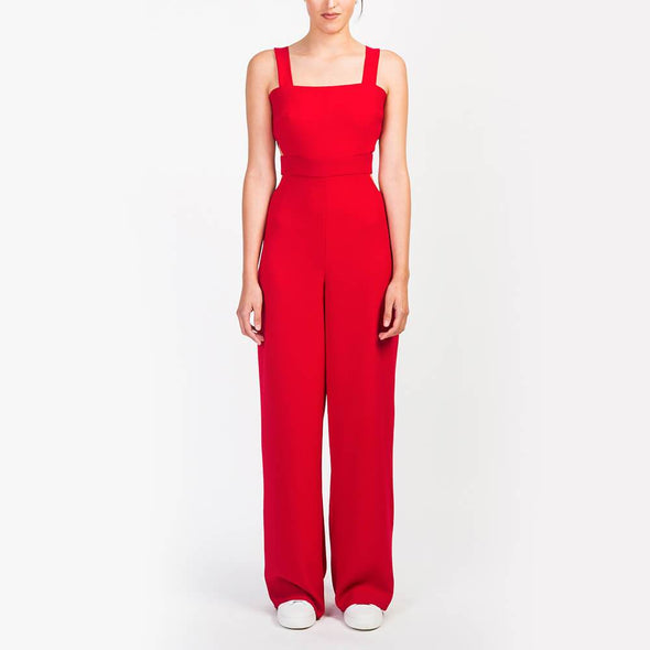 Red long jumpsuit with a square neckline.