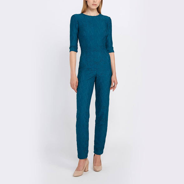 Blue jumpsuit with cigarette trousers and 3/4 sleeves.