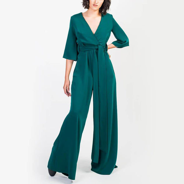 Green straight cut long jumpsuit with 3/4 sleeves.