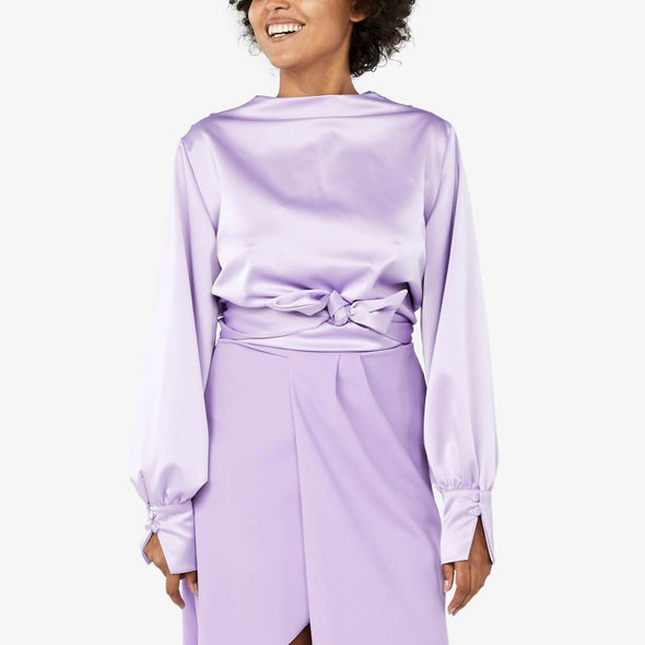 Lavender reversible blouse which can be worn in four different ways.